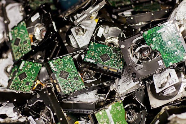 Closeup of many small circuit boards in a pile.