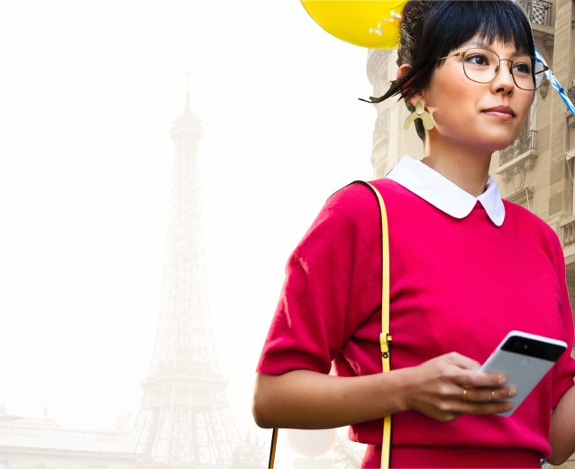 Woman holding phone and balloon